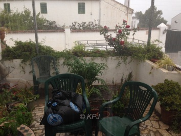 Raining – heavily – on the terrace, the lines in the photo are rain