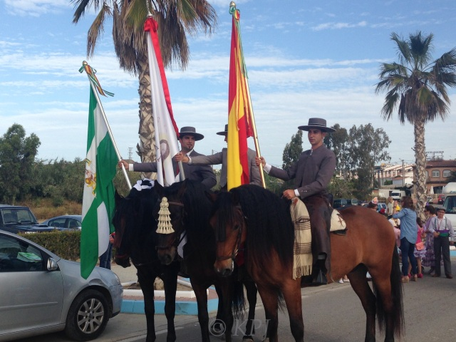 The three flag bearers, my neighbour on the left with the flag of Andalucía